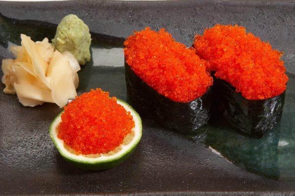 Orange tobiko wrapped in nori